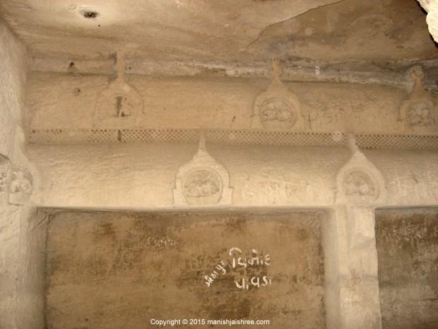 The faint ouline of various reliefs, Buddhist cave complex, Uparkot, Junagarh