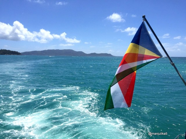 Seychelles flag, blue (hoist side), yellow, red, white, and green (bottom)