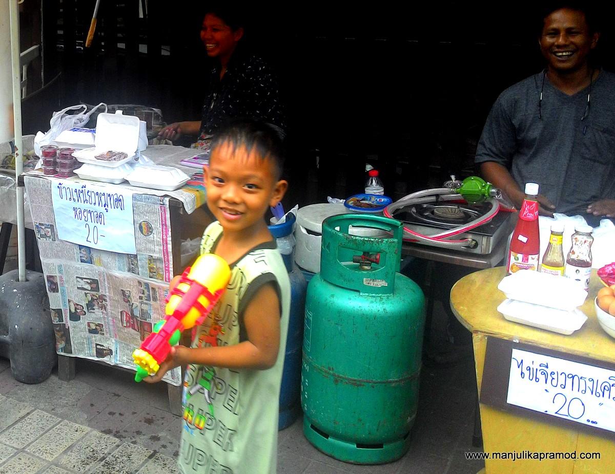 Holi in India, Songkran in Bangkok, Thailand,