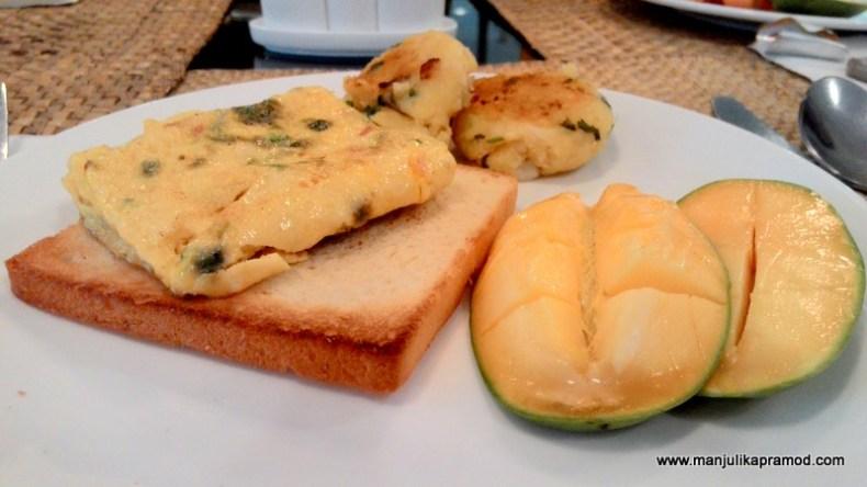 Potato tikki, Bread, Mango- breakfast