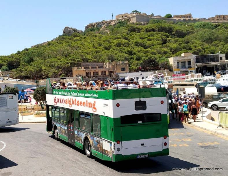 Gozo sightseeing bus, Hop on hop off in Malta, Charming lady, Gozo, Comino, Blue lagoon of Malta.