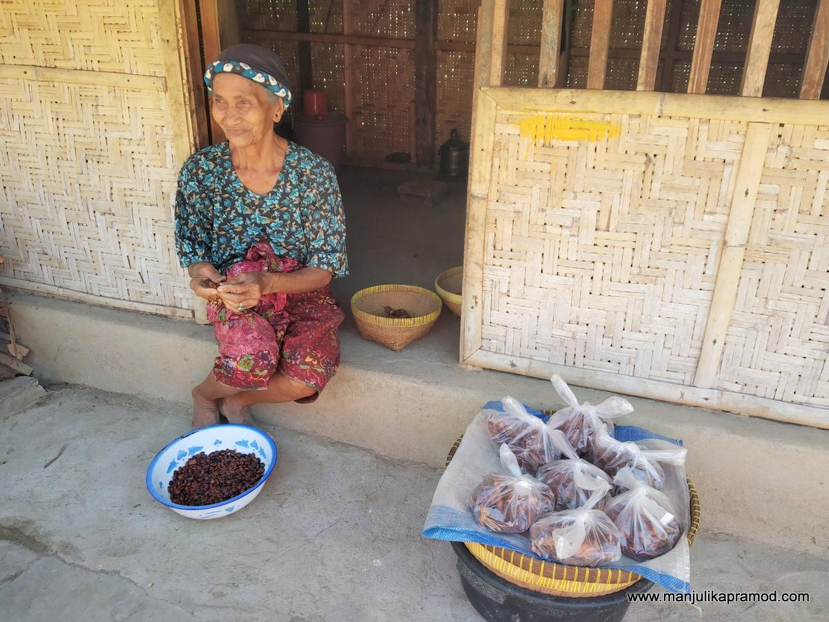 Sasak women sitting outside her house