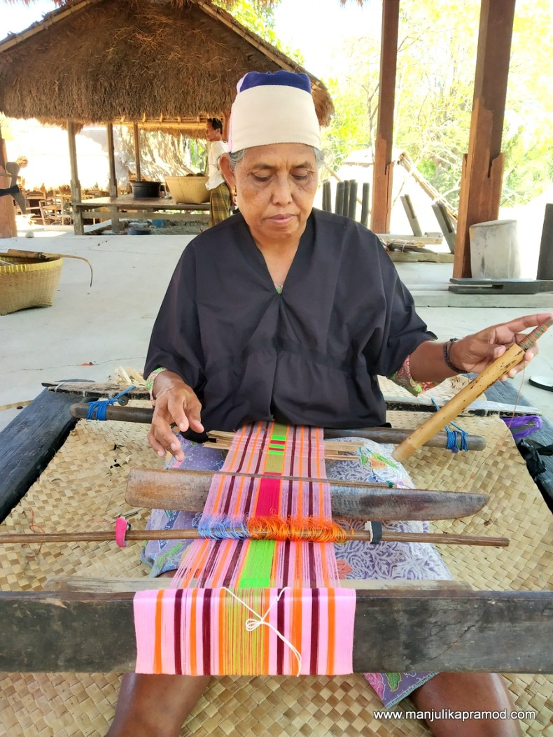 Picture of a woman who is weaving.  Shot in lombok