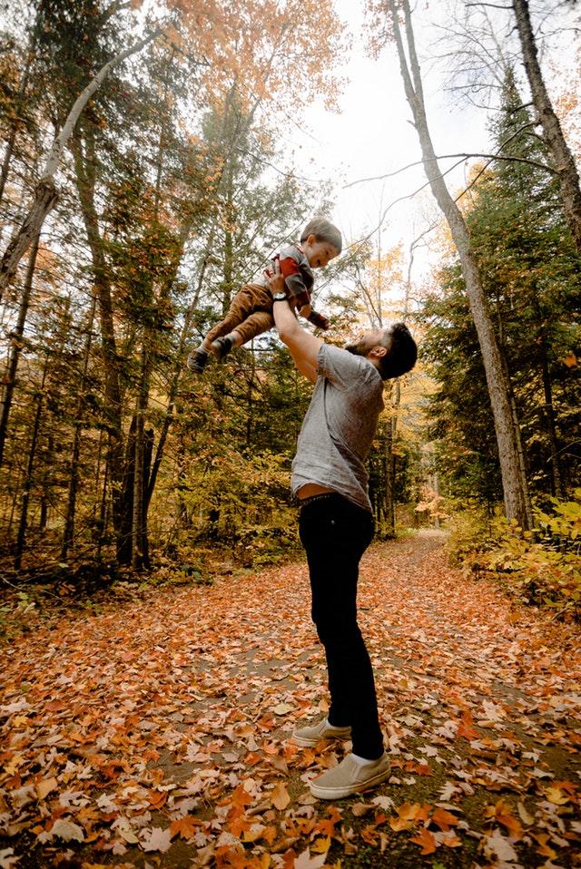 man-carrying-boy-near-forest-3074937
