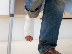 Leg with cast Manchester Personal Injury Lawyer