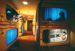 In the Ginza district, renting a capsule hotel room is about one-third the cost of a traditional room
