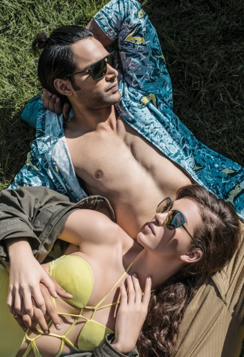 On Prabh: Canvas parka by Quiksilver; Khaki denims by Jack & Jones; Sunglasses by Prada; On Alicia: Canvas trench by Quiksilver; Bikini by Flirtatious; Sunglasses by Dolce & Gabbana