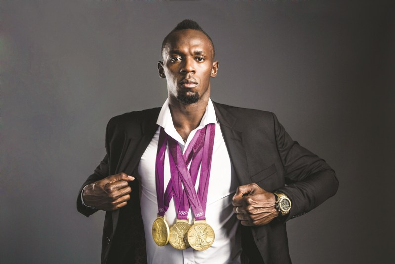 Bolt is wearing his Olympic golds around his neck and a Hublot Big Bang on his wrist-KB