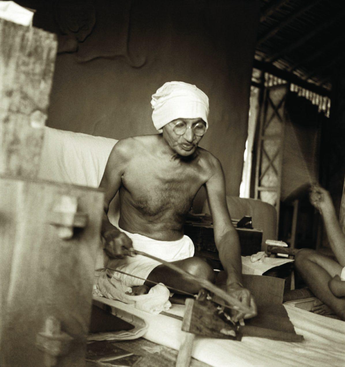 Gandhi spinning on Dhanush Takli, Sevagram Ashram