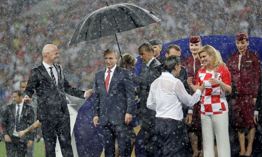 The Star Of The World Cup Appears To Be Vladimir Putin's Umbrella