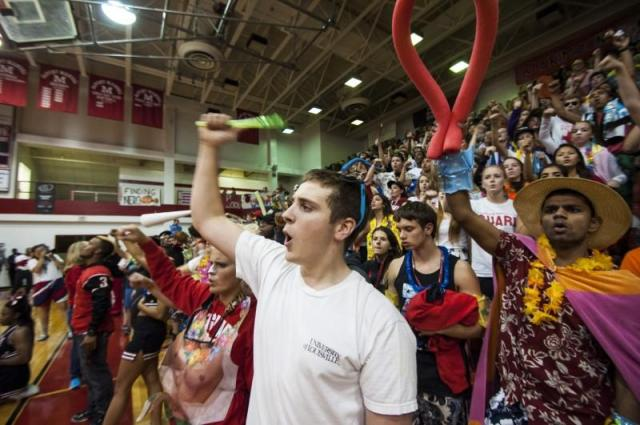 Jesse Smith(12) stands alongside his friends as he cheers with them. Photo by Jack Steele Mattingly