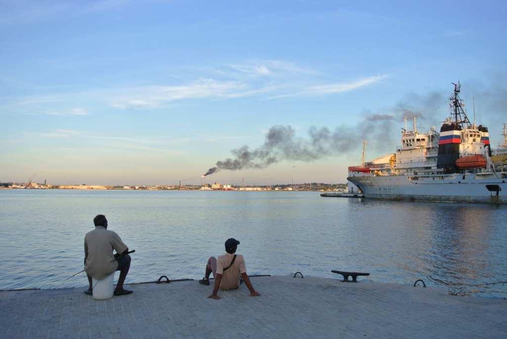 Men fishing on the docks in Havana