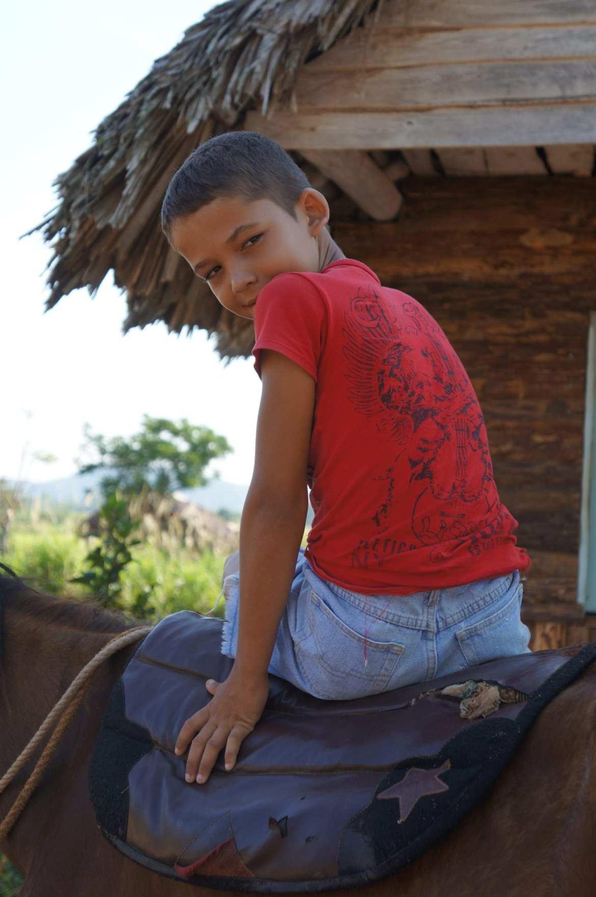 boy on a horse in vinales, cuba