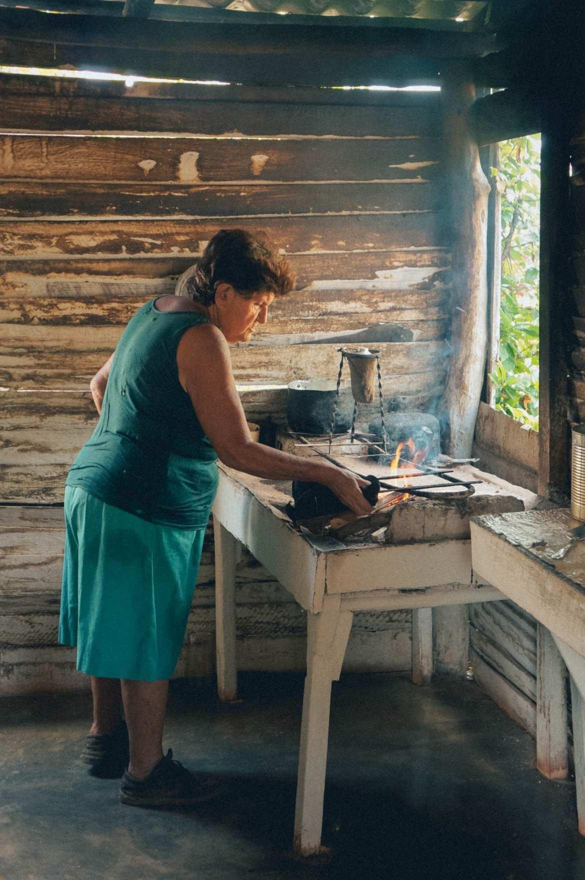 Cuban lady making coffee in vinales, Cuba