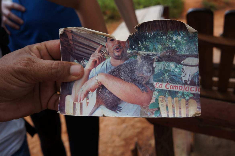A farmer with his pet Desmarest's hutia in vinales, cuba