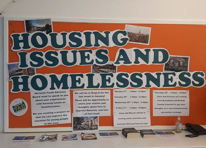 A notice board about youth housing issues and homelessness.