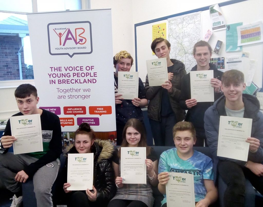 Young Commissioners holding certificates.