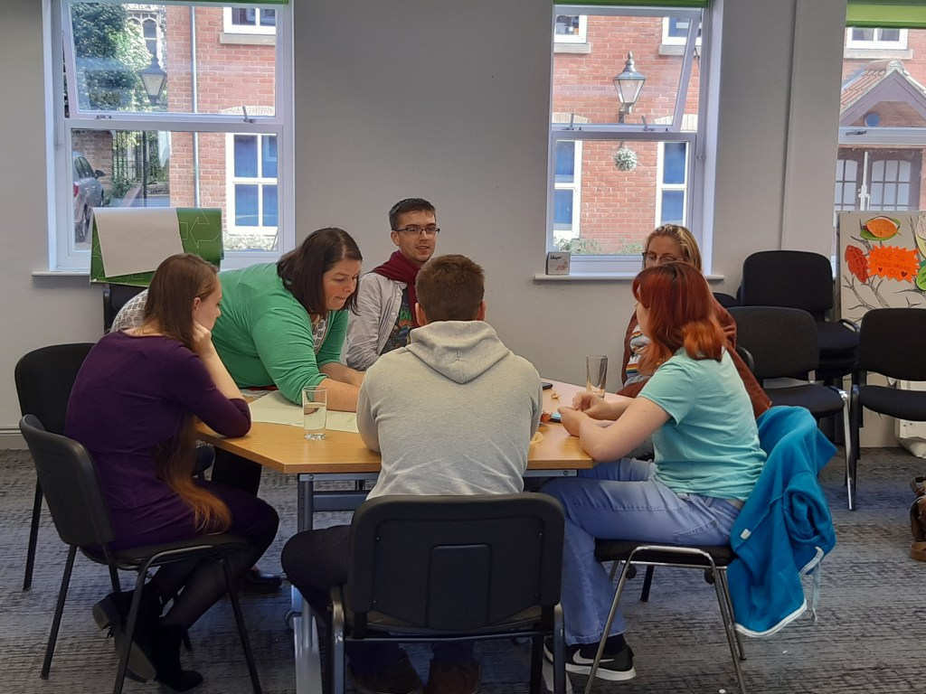 Young people and mental health professionals discussing services in Norfolk and Waveney
