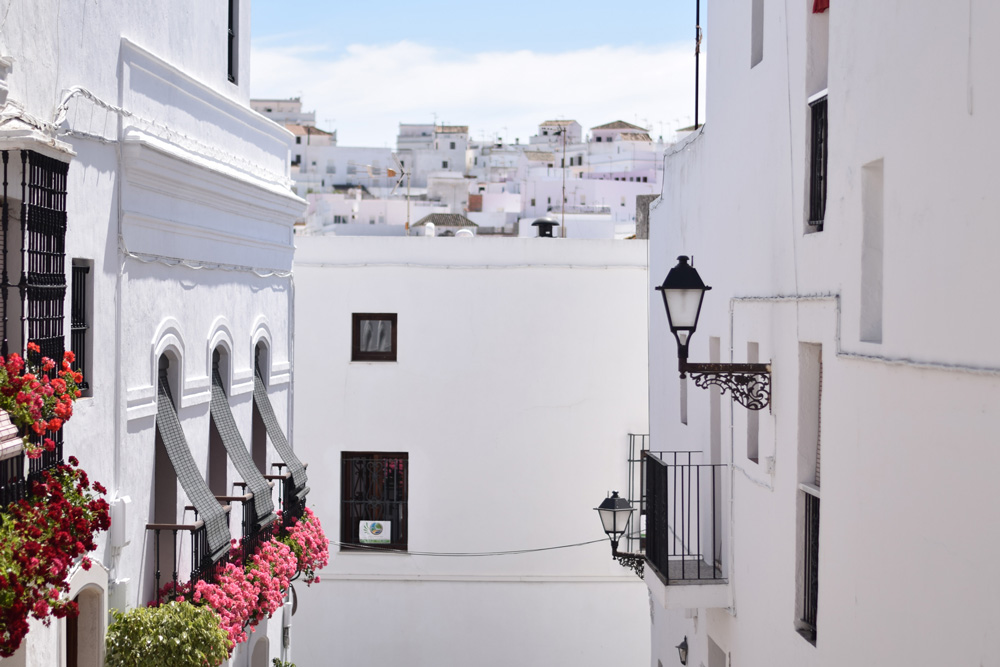 Image of Vejer de la Frontera Spain showing white washed houses, flower boxes and iron lanterns