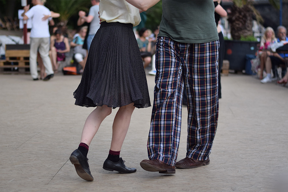 Photo of couple dancing along the River Spree in Berlin, Germany.