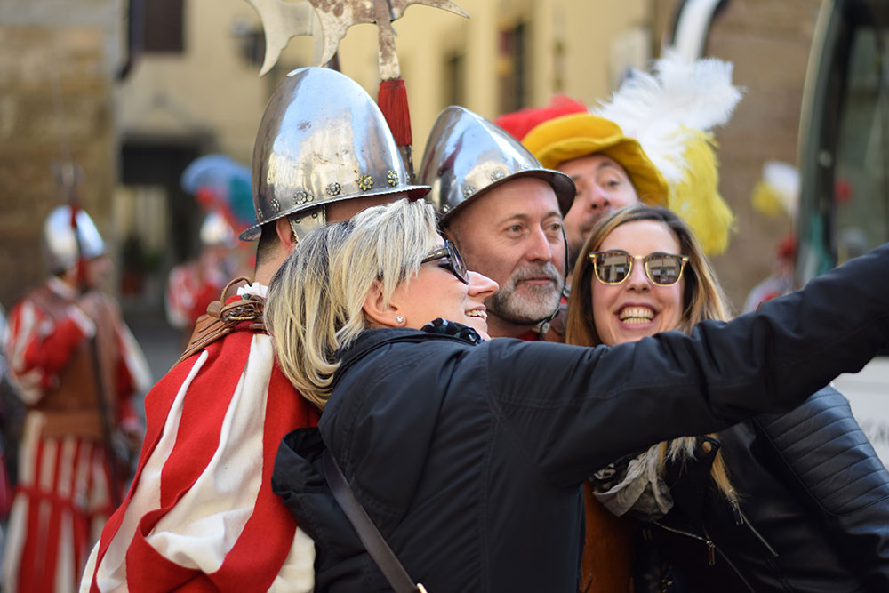 A photo of a group of friends posing for a 'selfie' during an Easter celebration in Florence, Italy