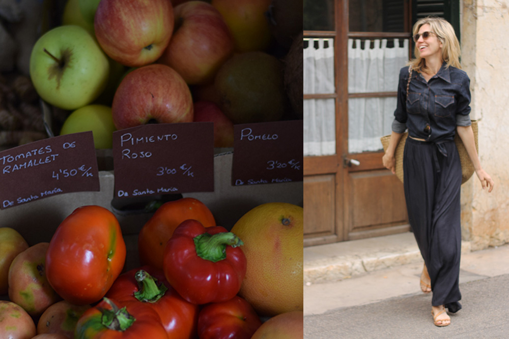 Photograph of fruits and vegetables for sale and a woman walking at the Santa Maria market in Mallorca, Spain.