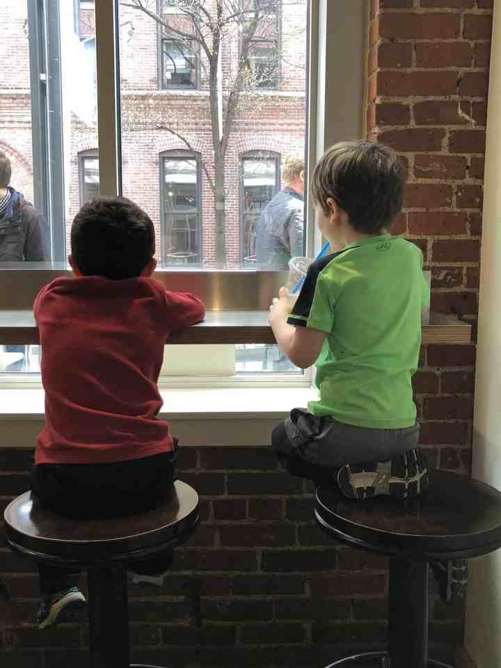two boys at flour cafe window