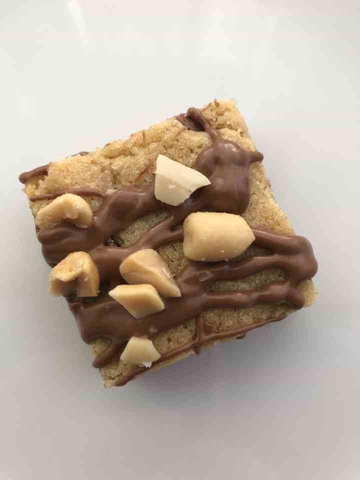 single peanut butter milk chocolate blondie on a white plate
