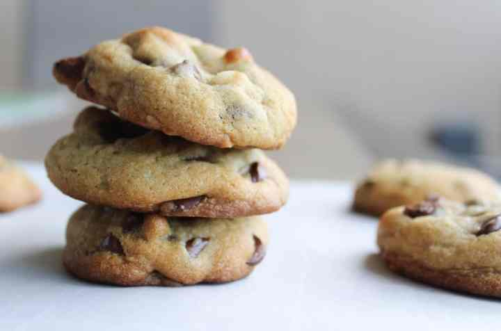 a stack of macadamia chocolate chip cookies on a countertop