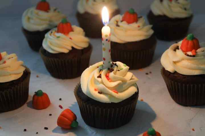 chocolate cupcakes with burning candle