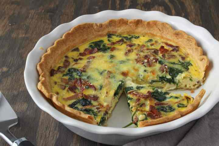 spinach bacon quiche with slice removed