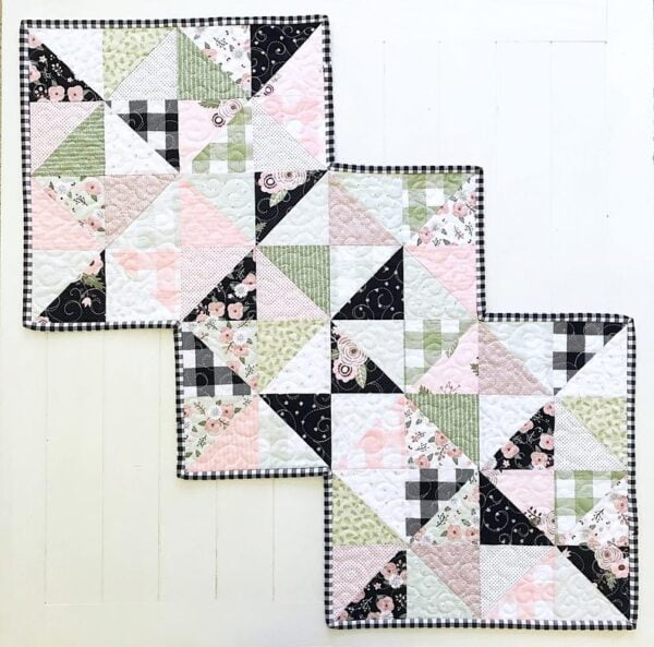 Rhapsody Whirl table runner pattern that's perfect for 1 charm pack and features a zigzag edge.