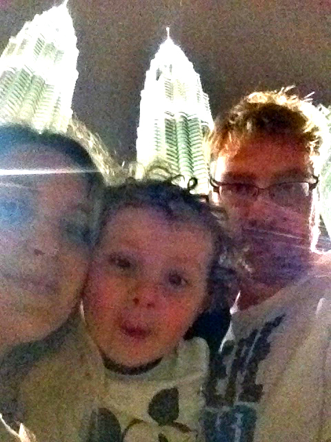 Bethaney of Go Click Travel and family. Petronas Towers in Malaysia.