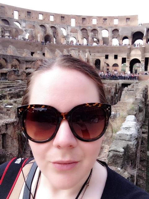Megan of Meganotravels outside Rome's Collosseum.