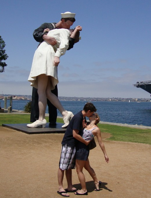 Replicating the famous kiss of the Unconditional Surrender statue in San Diego, CA. - Helen Anne Travis of From Way Up High.