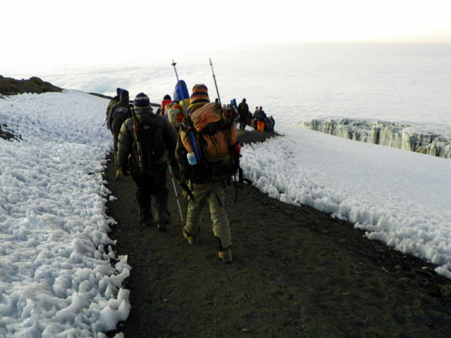 Hiking the final plateau to Uhuru Peak.