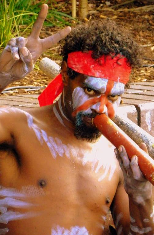 Indigenous Australian performs the Didgeridoo on Sydney Harbour