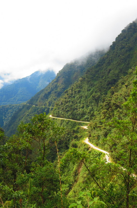 A 69 km narrow one way road which snakes it's way around the side of a very sheer cliff, 'Death Road' is known as the most dangerous road in the world.