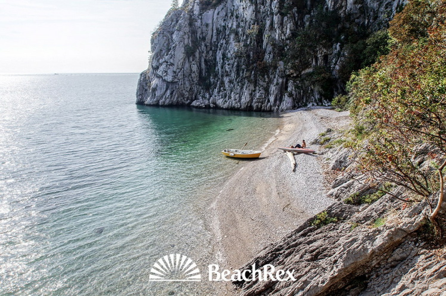 How about a beach with a view of a castle? There is one in the Italian town Duino.