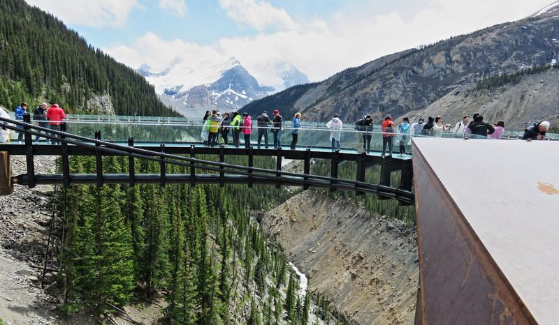 Jasper Glacier Skywalk. Our feet seemed to float on the glass floor that juts over the Sunwapta Valley, the wind rising as the river rushes far below.