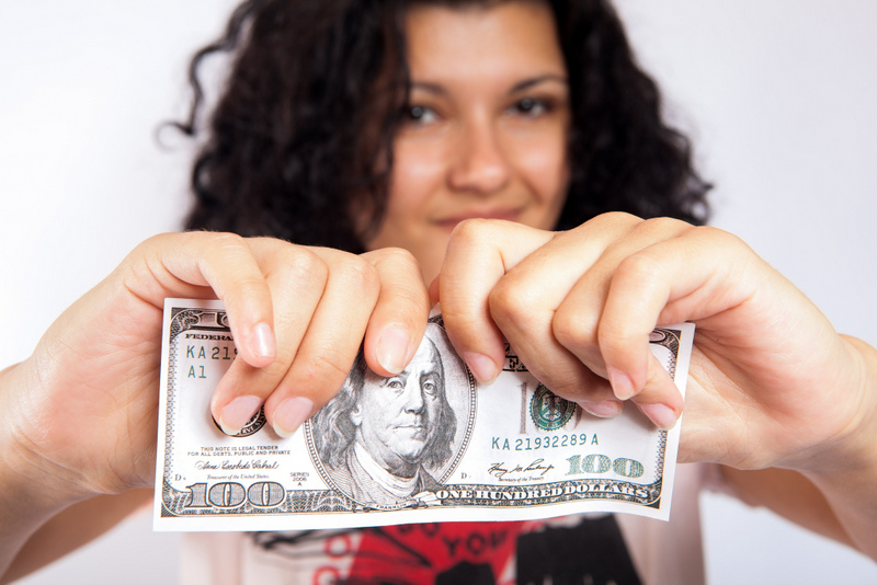 Girl tearing money