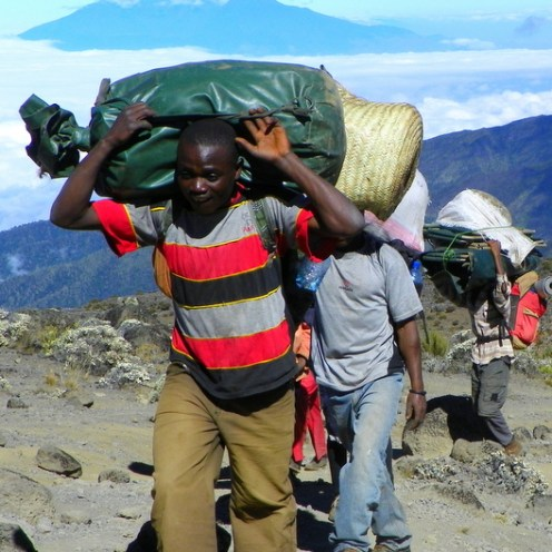 When climbing Kilimanjaro, The staff will carry your main bag up to a maximum weight of 15kgs plus all the tents, kitchen equipment, food, fuel, tables and chairs.