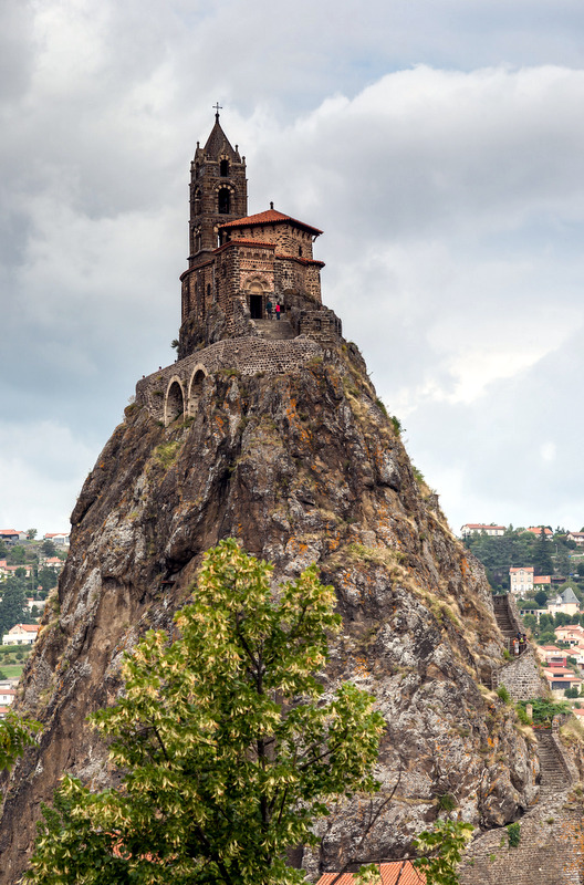 Often an old chateau or chapel will sit atop these cliffs, perched like Dracula's castle over the villages below.