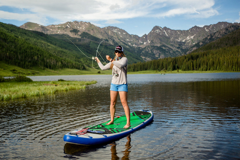 Fishing while paddleboarding