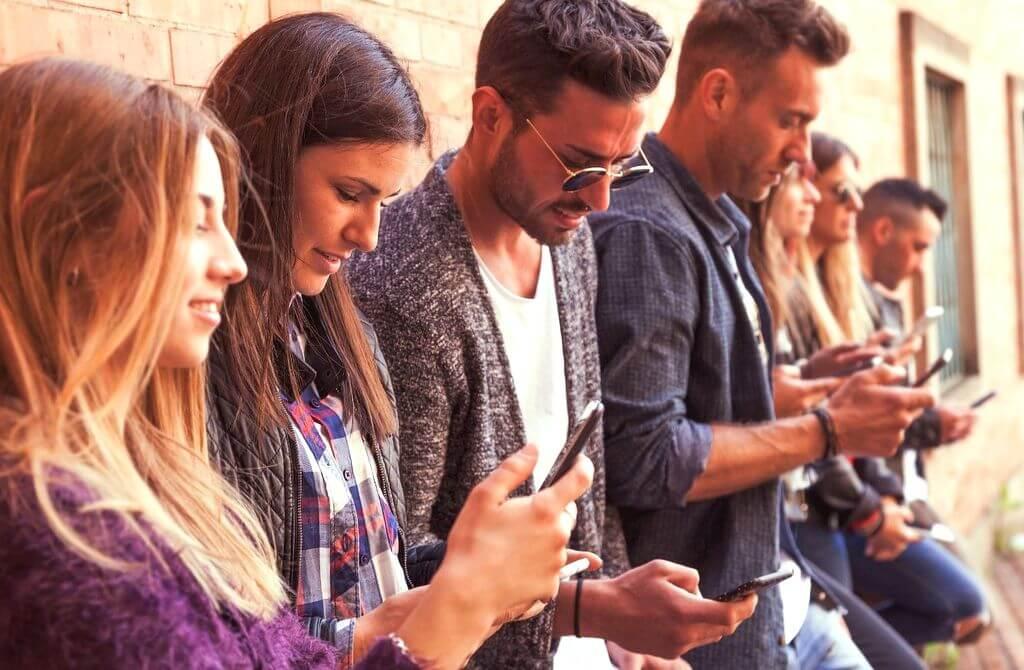 Group of people on their phones RF