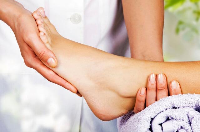 Foot massage in spa salon RF