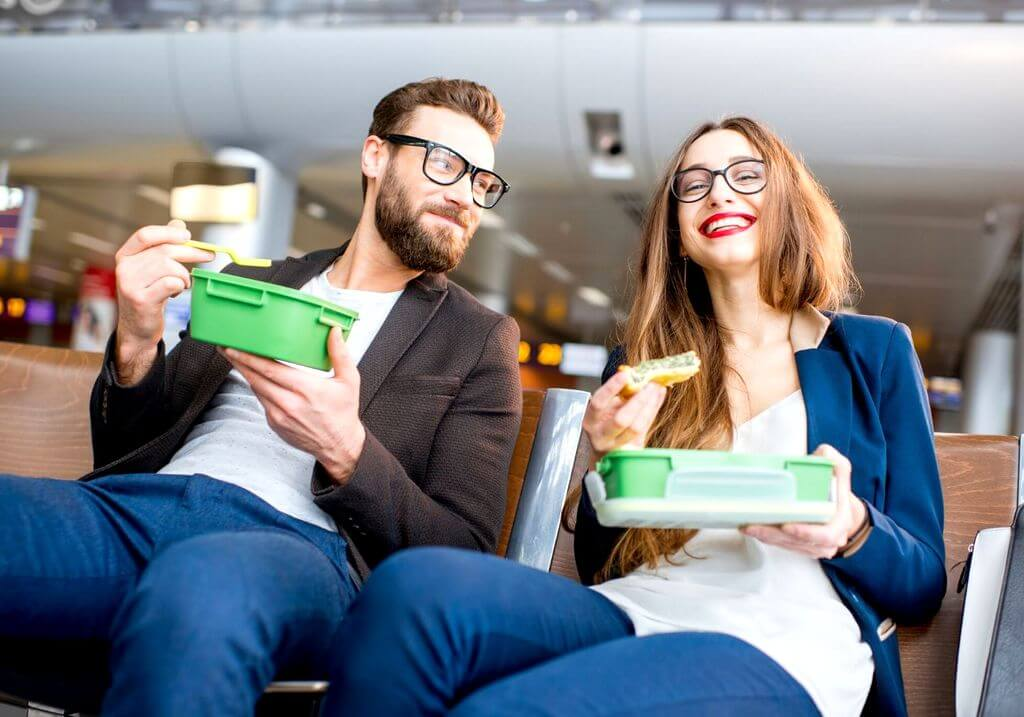 Business travel couple airport eating food RF