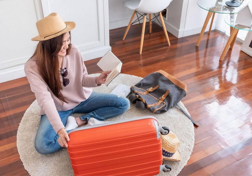 Female Traveler packing suitcase bag luggage list RF