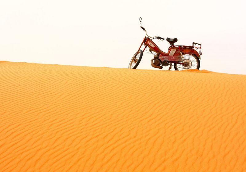 Motorbike dunes sand Morocco RF