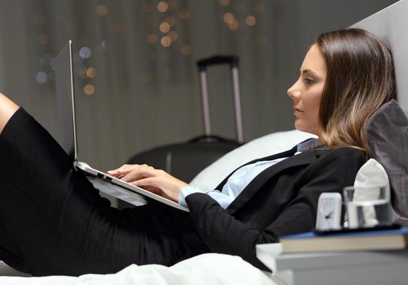 Business woman hotel accommodation laptop computer RF